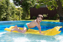 Little boy in the pool Stock Image