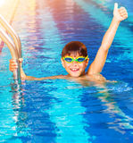 Little boy in the pool Stock Photos
