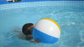 Little boy in the pool at home stock video footage