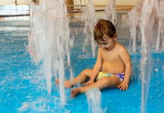 Little boy in pool Stock Photo