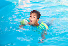 Little boy in the pool Stock Images