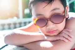 Little boy in the pool. Summer holiday concept royalty free stock images