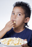 Little boy and pop corn. On white background Stock Photos