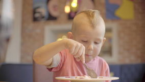 Little boy portrait enjoing his healthy meal stock footage