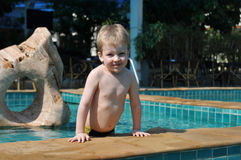 Little boy portrait in a pool Stock Photos