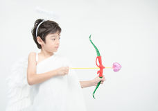 Little boy portrait pretend as cupid with wing Stock Photo