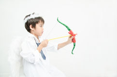 Little boy portrait pretend as cupid with wing and arrow Stock Photography
