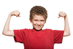 Little boy portrait strong flexing muscle biceps. Little caucasian strong boy portrait flexing muscle biceps mischief isolated studio on white background stock image