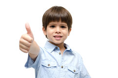 Little boy portrait with thump up Stock Photo