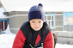 Little boy portrait at winter playing outdoor. Winter activity - boy portrait at winter playing outdoor in warm clothes Royalty Free Stock Photo
