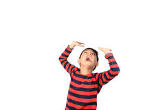 Little boy pose like taking heavy thing over his head isolate Stock Photography