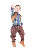 Little boy posing in cowboy costumes Royalty Free Stock Photography