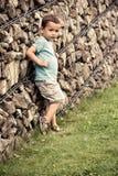 Little boy posing near the wall Stock Photography