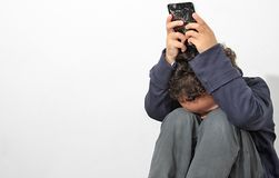 Boy in poverty. Little boy in poverty and crying royalty free stock image