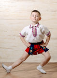 Little boy practicing a ballet pose Royalty Free Stock Photo