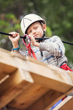 Little boy practicing on the rope track Stock Images