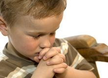 Little boy praying. Five year old boy praying Stock Photo