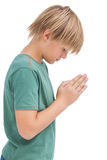 Little boy praying with bowed head Stock Image