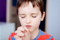 Little boy praying. Boy`s prayer. Stock Photo