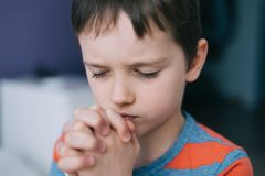 Little boy praying. Boy`s prayer. Stock Images