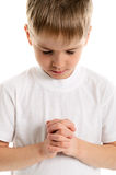 Little boy praying - closeup Royalty Free Stock Images