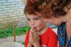 Little boy praying Stock Photography