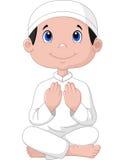 Little boy praying Stock Images