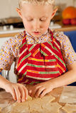 Little boy prepare christmas cookies Stock Photos