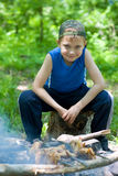 Little boy is preparing barbecue Royalty Free Stock Photography