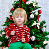 Little boy preparing for Christmas holidays Stock Photos