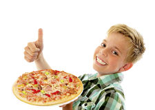 Little boy preparing homemade pizza Stock Photos