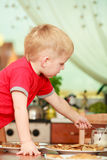 Little boy preparing pancakes for breaktfast Royalty Free Stock Image