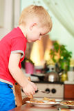 Little boy preparing pancakes for breaktfast Stock Photography