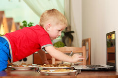 Little boy preparing pancakes for breaktfast Royalty Free Stock Images