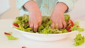 Little boy preparing salad stock video footage
