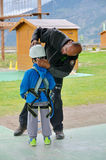 Little boy preparing to enter a challenging rope course Royalty Free Stock Photography