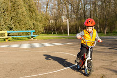 Little boy preparing to ride his bicycle Stock Photo