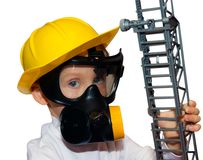 Little boy - preschooler in fireman face mask Stock Photos