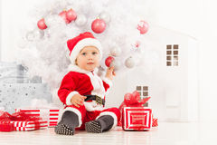 Little boy with presents under the Christmas tree Royalty Free Stock Image