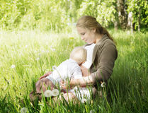The little boy pressed his lying hugging pregnant mom royalty free stock images