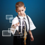 Little boy pressing high tech type Stock Images