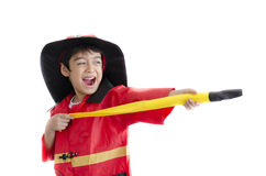 Little Boy Pretend As A Fire Fighter Stock Photography