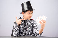 Little boy pretend as a magician performance with fun Stock Images