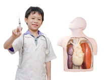 Little boy pretend to be doctor Stock Photos