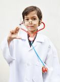 Little boy pretending to be a doctor Royalty Free Stock Images
