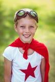 Little boy pretending to be superhero. In park Stock Image