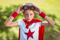 Little boy pretending to be superhero. In park Royalty Free Stock Images