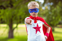 Little boy pretending to be superhero pointing Royalty Free Stock Photo