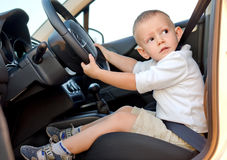 Little boy pretending to drive Royalty Free Stock Photography