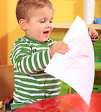 Little boy proudly shows his self-drawn picture Royalty Free Stock Images